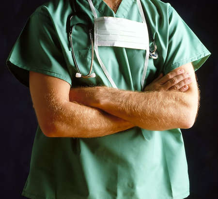 Doctor with Mask & Stethoscope arms folded Stock Photo - 453071