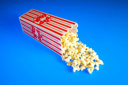 old fashioned: Popcorn spilling out of old fashioned box Stock Photo