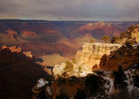 Grand Canyon in winter with snow patches on closest cliffs photo