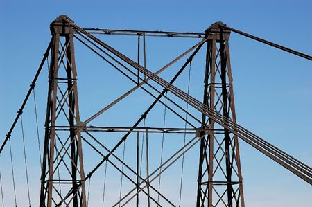 superstructure: Black Iron bridge superstructure against blue sky Stock Photo