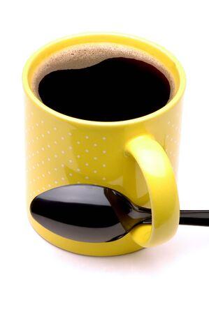 Yellow Coffee Mug with Black Spoon through handle