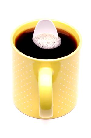 Yellow Coffee Cup with White Plastic Spoon inside Stok Fotoğraf