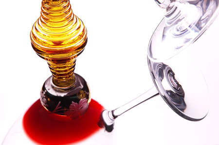tilted: Wine Glass tilted and leaning on golden glass with reflections Stock Photo