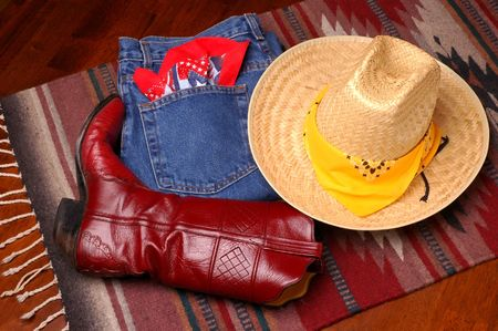 Cowboy Hat, blue Jeans & Boot on western rug Stock Photo - 876264
