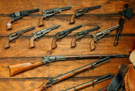 pistolas: Pantalla de Old West Pistolas y rifles