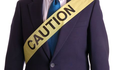 Businessman in suit with caution tape wrapped around him Stock Photo - 904776