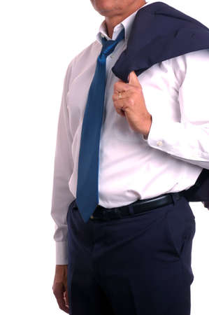 undone: Businessman with tie undone and suit jacket over shoulder Stock Photo