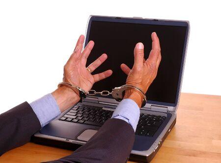 cuffed: Businessmans esposaron las manos hacia llegar a la pantalla de la computadora port�til - aislados m�s de blanco  Foto de archivo