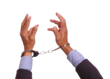 handcuffed hands: Businessmans handcuffed hands reaching up - isolated on white