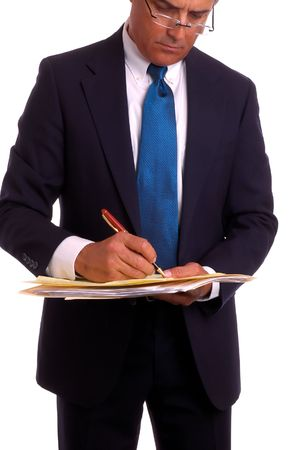 Businessman in suit with file folder jotting notes Stock Photo