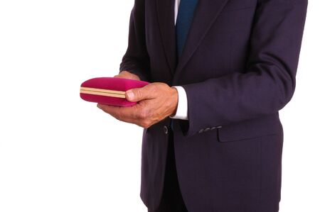Man in dark suit with jewelry gift box Stock Photo - 954023