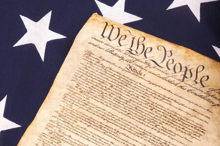 state government: Close up of United States Constitution on Flag