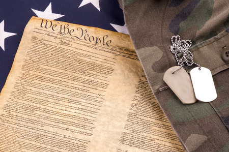 military uniform: Military Dogtags on American Flag and Constutition and Military Uniform