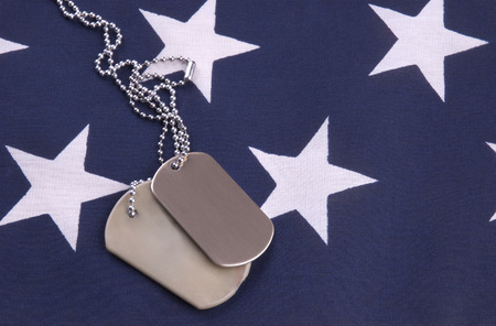 Military Dogtags on star field of american flag Stock Photo - 1397354