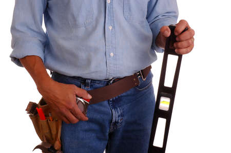 toolbelt: Carpenter wearing a toolbelt holding a long level isolated over white