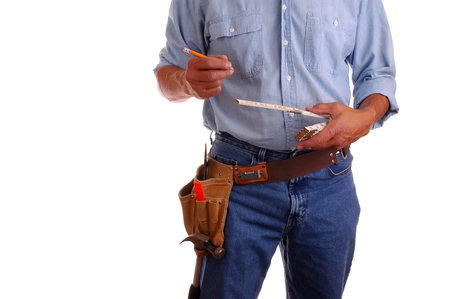 toolbelt: Carpenter wearing a toolbelt and holding pencil & ruler, isolated over white