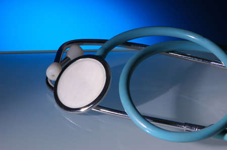 Stethoscope with blue gradated background and reflections Stock fotó