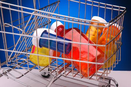 Assorted Prescription and Medicine Bottles in Shopping Cart