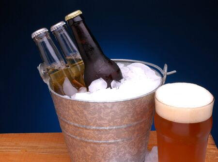beer bucket: Bottles of Beer in a Galvanized bucket with ice and glass of beer