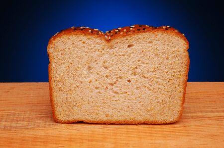 Slice of Multi-Grain Bread on wood with blue spotlight background