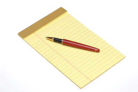 legal pad: Wooden Pen on Yellow Legal Pad isolated over white