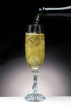 Bubbly Champagne Pouring Into a Crystal Flute
