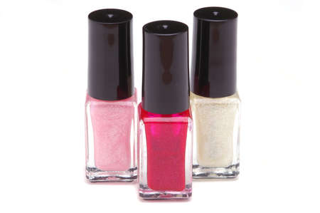 nail polish bottle: Three Colors of Nail Polish Bottles Grouped Together on White Background with slight shadow