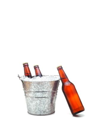 Bucket of Beer with one bottle leaning on bucket isolated over white with slight shadow photo