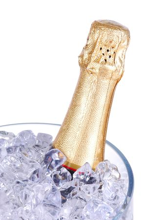 Champagne Bottle in Crystal Ice Bucket isolated over white photo