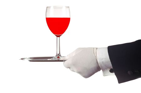 Red Wine Glass Being Served by Waiter on Silver Tray isolated over white photo