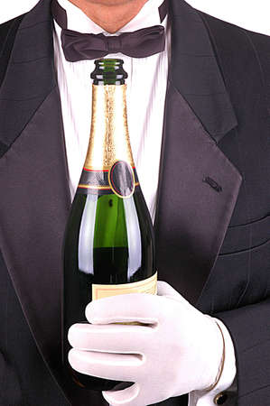 Man in Tuxedo with Champagne Bottle close-up shot- vertical
