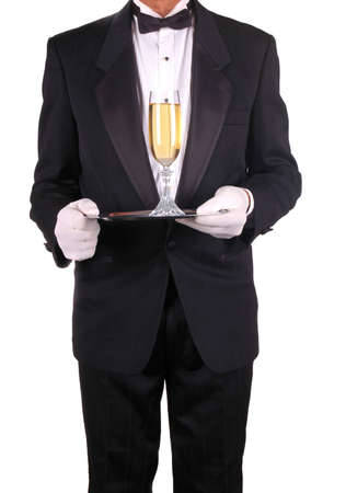 Champagne Glass on Silver Tray  Being Served by Waiter in Tuxedo isolated over white photo