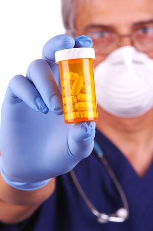Doctor Holding Prescription Medicine Bottle with selective focus Stock Photo - 2181064