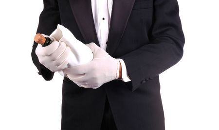popping the cork: Man in Tuxedo Popping Cork on a Champagne Bottle close-up shot- horizontal Stock Photo