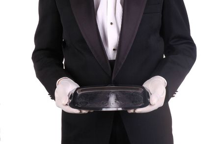 Man in Tuxedo and Formal Gloves holding Silver Tray isolated over white Stock Photo