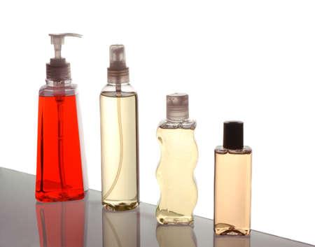 bodywash: Four Plastic Bottles on Bathroom Cabinet Shelf isolated over white