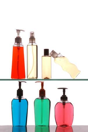 Plastic Bottles on Bathroom Cabinet Shelves isolated over white