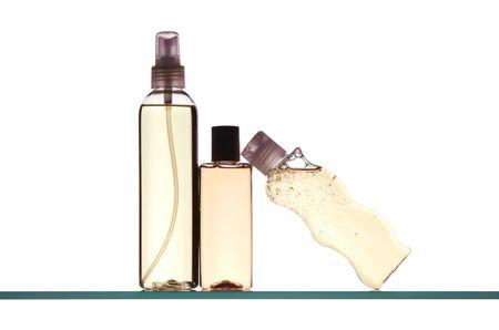 bodywash: Three Plastic Bottles on Bath Cabinet Shelf isolated over white