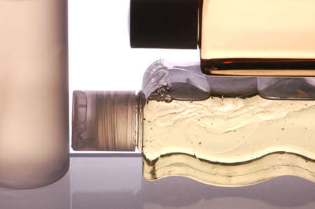 bodywash: Close up of Three Plastic Bottles Two on their sides isolated over white