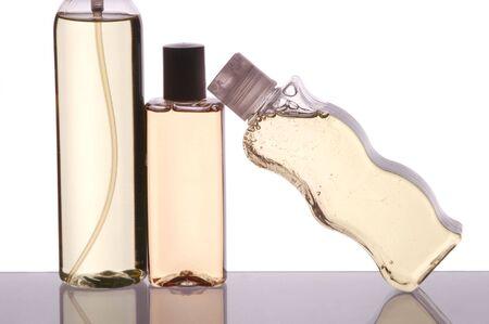 bodywash: Close up of Three Plastic Bottles on Bath Cabinet Shelf isolated over white Stock Photo