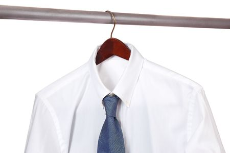 One white Dress Shirt and Tie on Hanger isolated Stock Photo