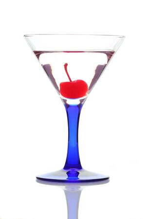 Cocktail in Martini Glass with Cherry isolated over white