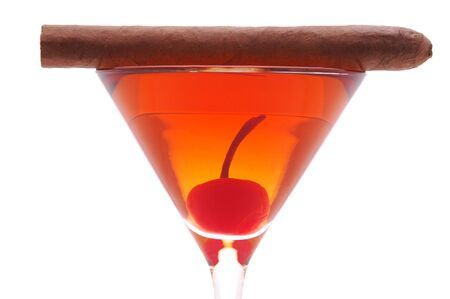 Rob Roy in Martini Glass with Cherry and Cigar isolated over white photo