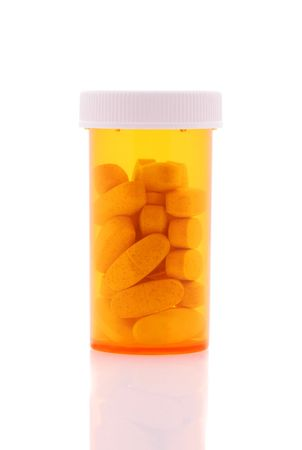 Prescription Bottle with pills isolated over white