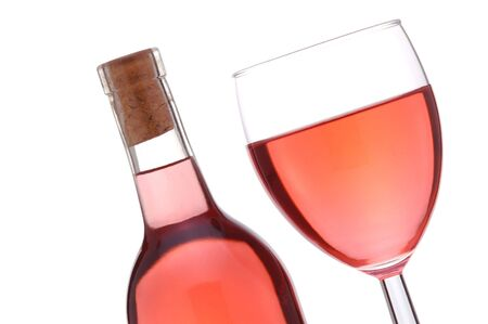 white zinfandel: Blush or Rose Wine Bottle and Glass at a slant isolated over white