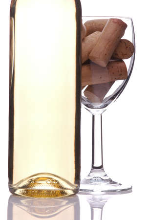 Wine Bottle with Corks in Wineglass isolated over white