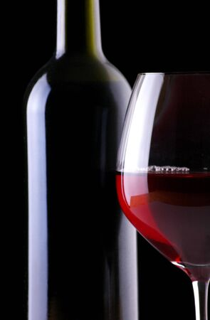 Red Wine Bottle and Wineglass on Black Background