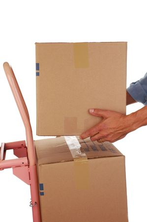 hand truck: Man Stacking a Moving Box on Hand Truck isolated on white Stock Photo