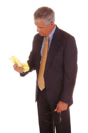 Mature Businessman Standing Crumpled Sheet of Paper isolated over White Stock Photo - 2997576