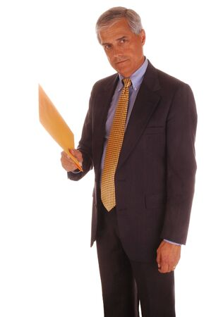 Mature Businessman Standing Holding Envelope isolated over White Stock Photo